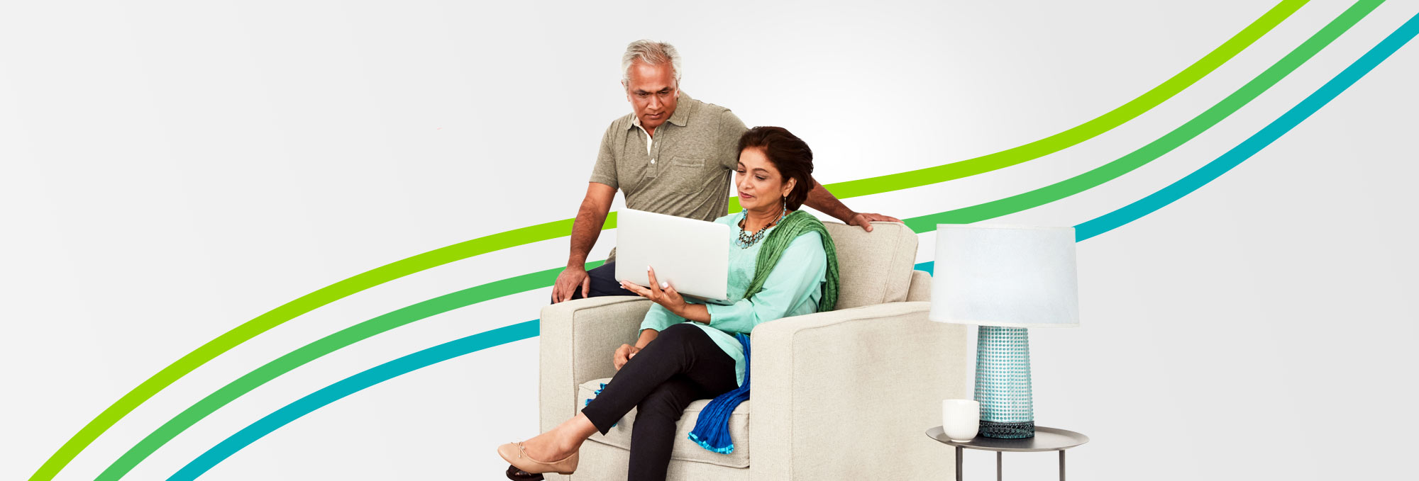 Sitting couple with laptop