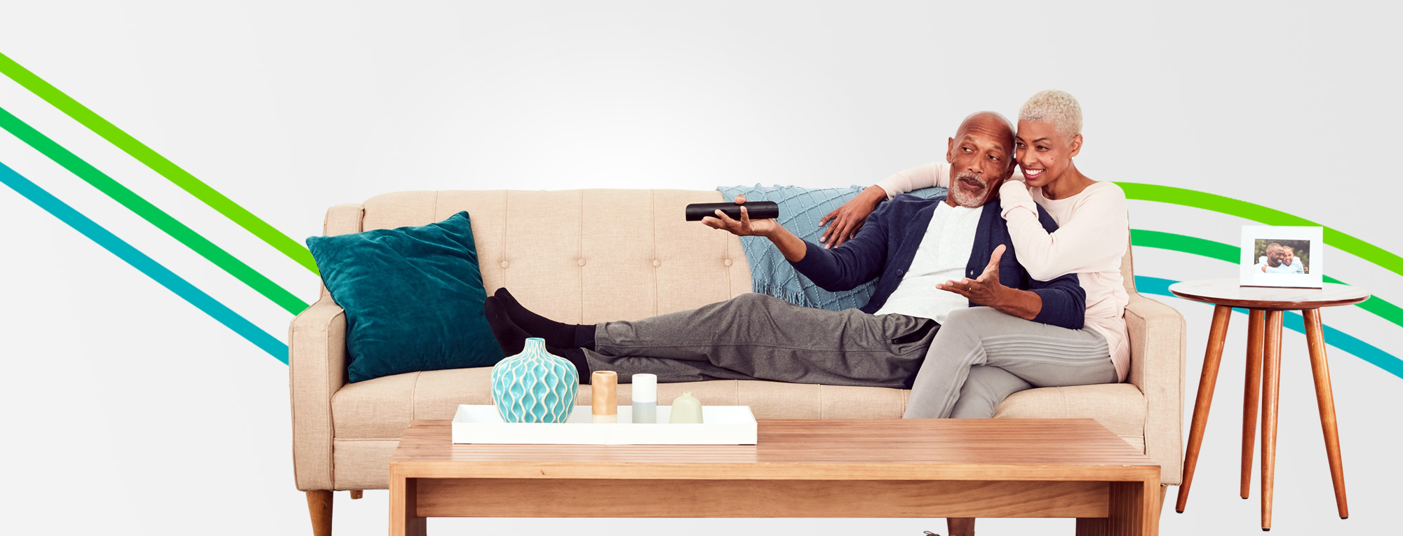 Retired couple sitting on sofa featured in an article about retiring married couples